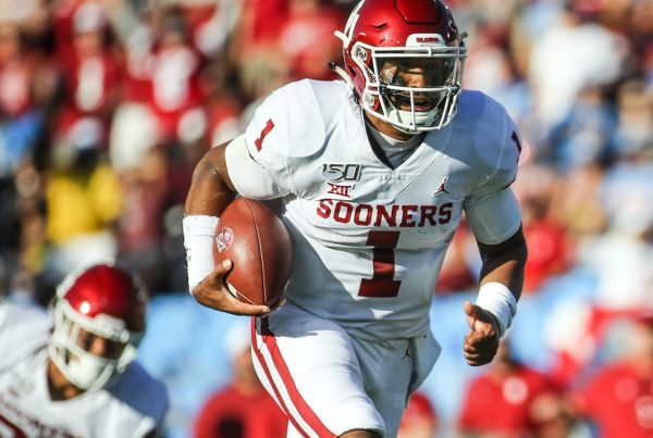 Oklahoma Sooners quarterback Jalen Hurts (1) runs for a 30-yard touchdown on 4th down and 3 to give Oklahoma a 7-0 lead in the first quarter; Oklahoma defeated UCLA 48-14, Sept 14, 2019, Pasadena, CA. Photo Credit: Steve Cheng | Under Creative Commons License