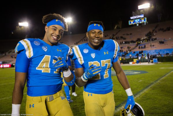 UCLA Bruins linebacker Shea Pitts (47) and running back Joshua Kelley (27) after the game against Cal; Cal at UCLA, November 30, 2019, Los Angeles, CA. Photo Credit: Steve Cheng | Under Creative Commons License